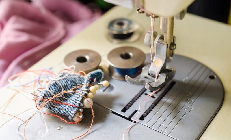 a needle of sewing machine closeup