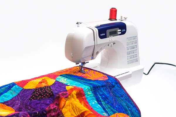 Brother sewing machine with a piece of quilting fabric