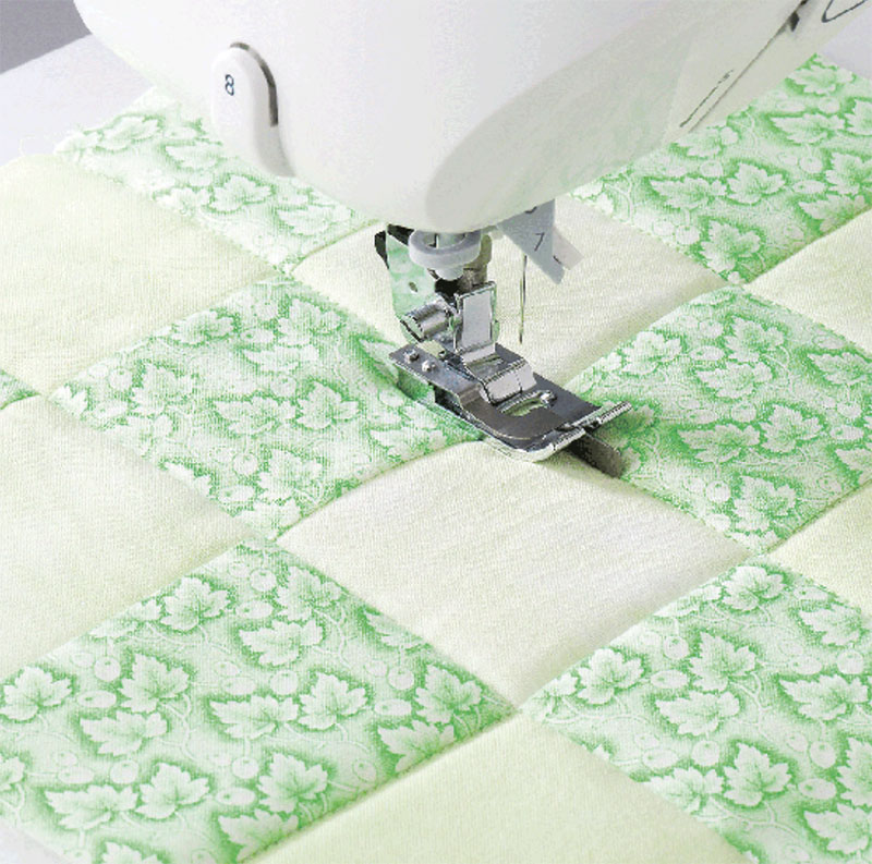 Sewing machine presser foot and a piece of quilting fabric