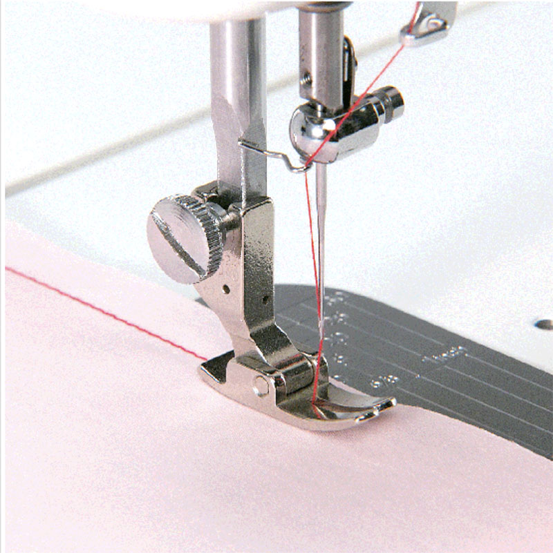 Sewing machine stitches on a pink color fabric