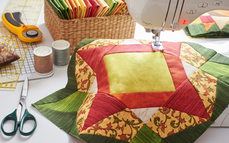 Sewing machine with a colorful quilting fabric