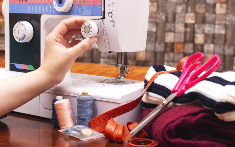 adjusting tension on a sewing machine