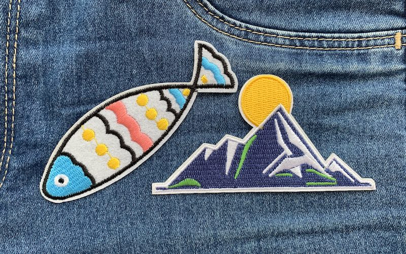 colorful patches on a denim fabric