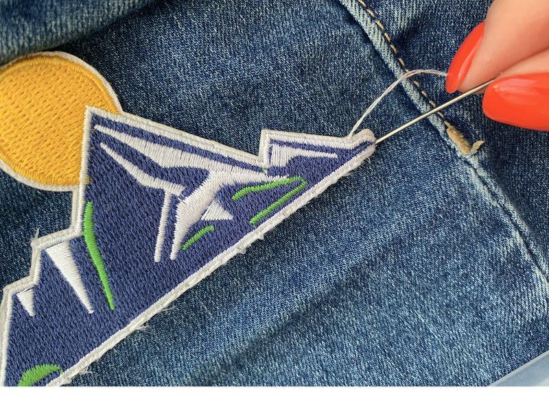 Final stitch sewing a patch to a denim fabric