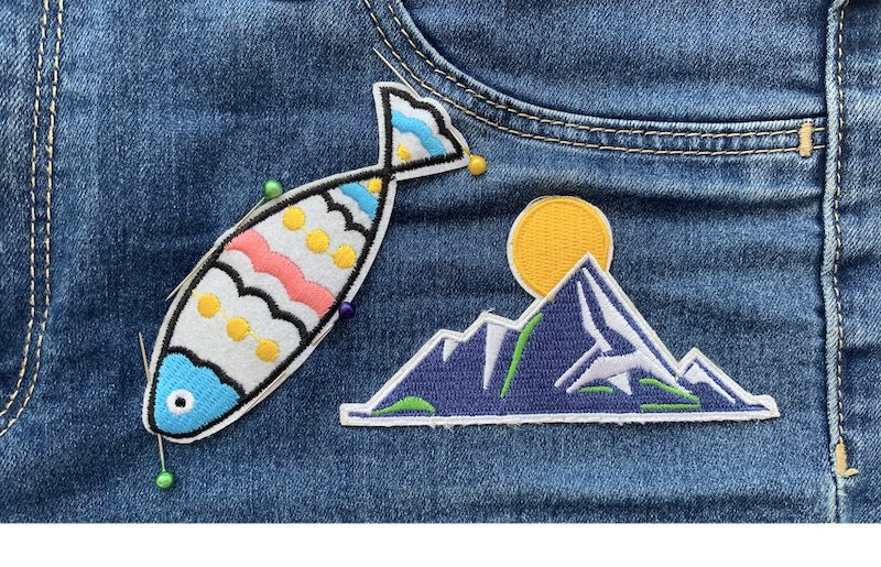 Two patches on a denim fabric
