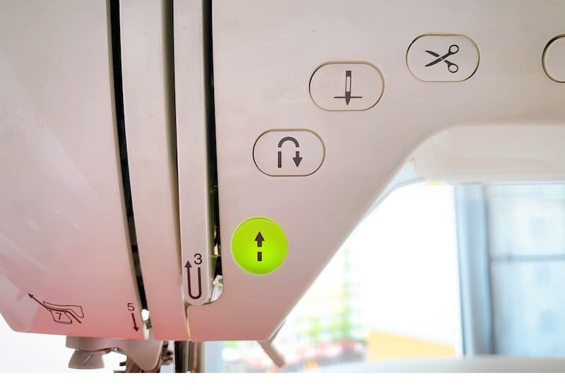sewing machine control buttons close up