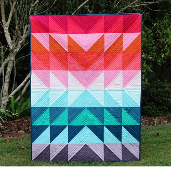 bright quilt blanket with basic half-square triangle pattern