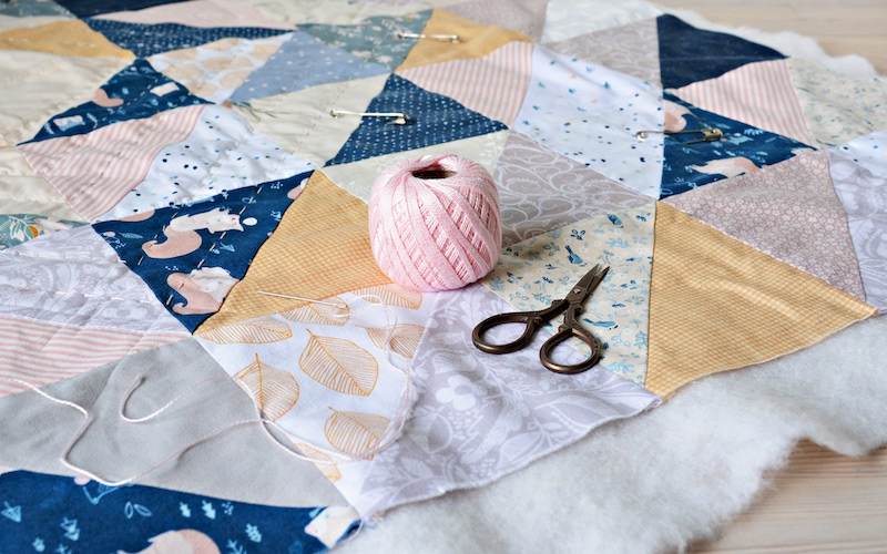 the process of sewing a quilt blanket