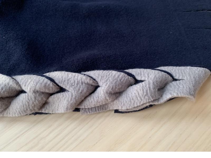 a fleece fabric with a braided edge