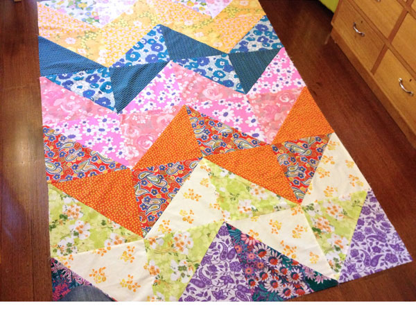 colorful patchwork duvet cover on a wooden floor