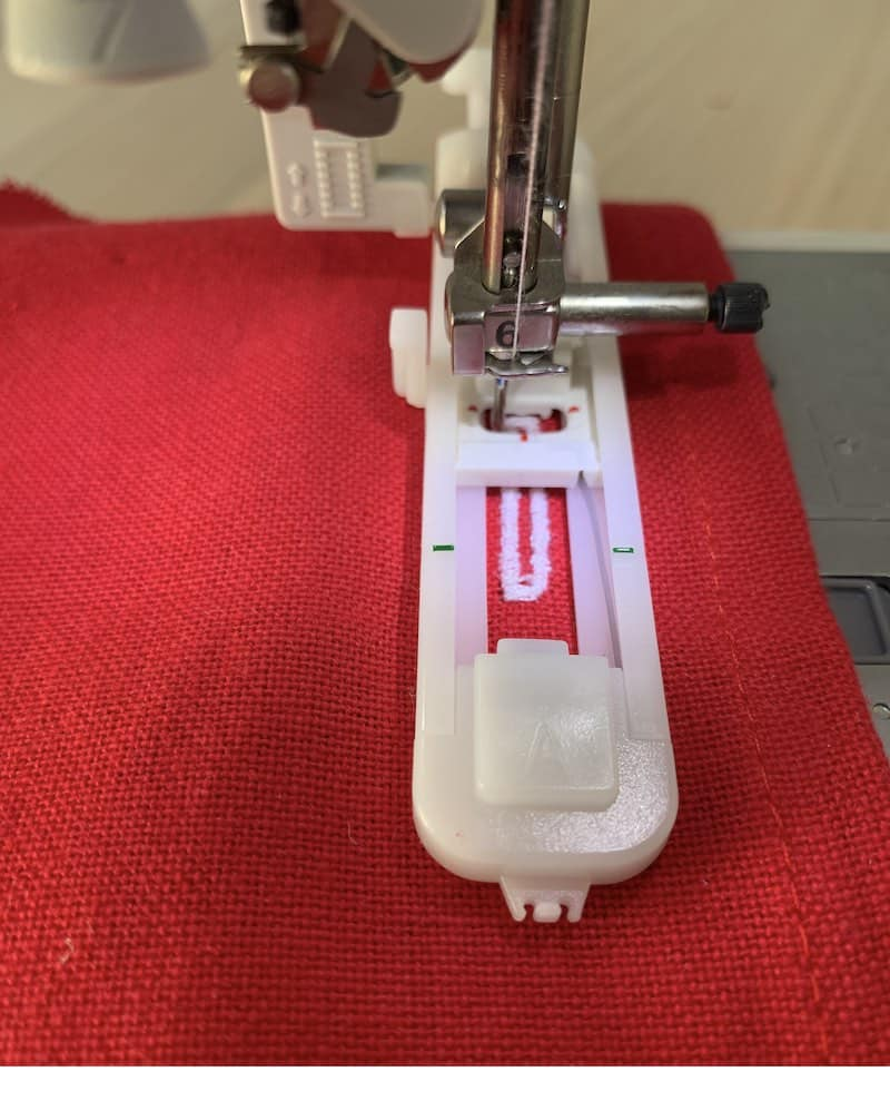 the process of sewing a buttonhole on a sewing machine