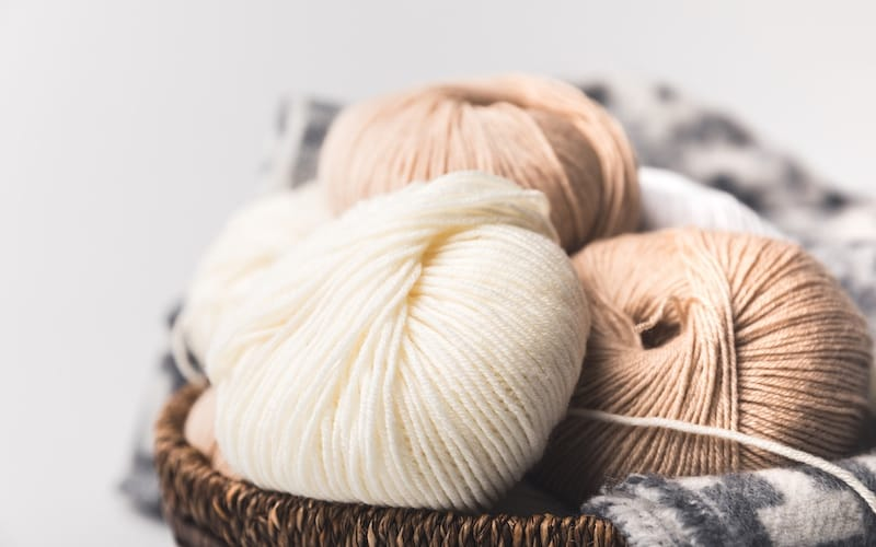 worsted weight yarn in a basket