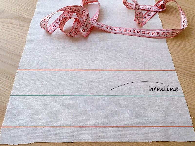 hemline marked on a piece of white fabric
