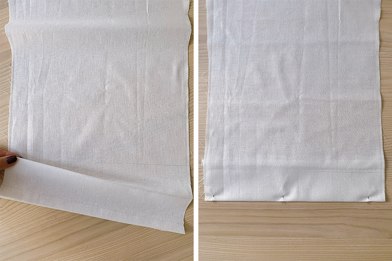 folded a pinned white piece of fabric