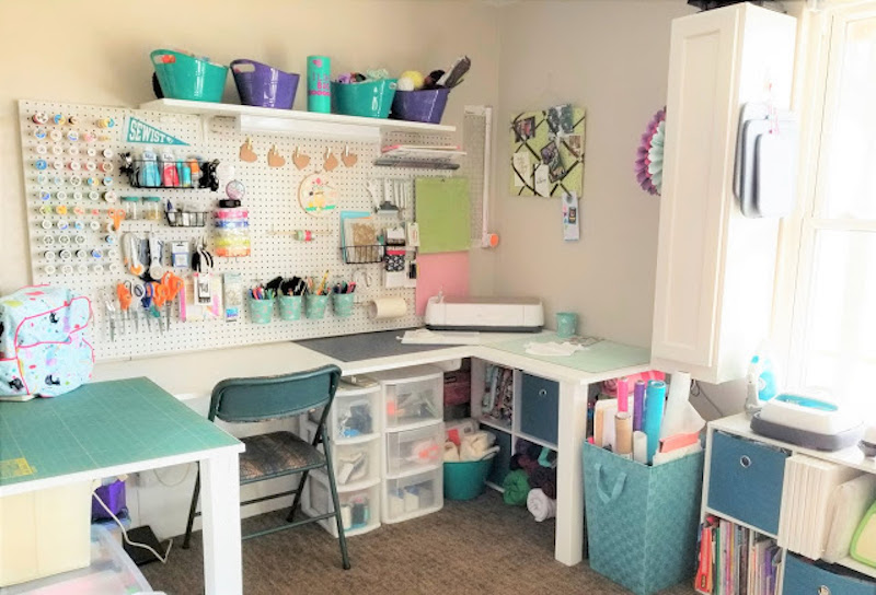 sewing room with tables, chair and peg board