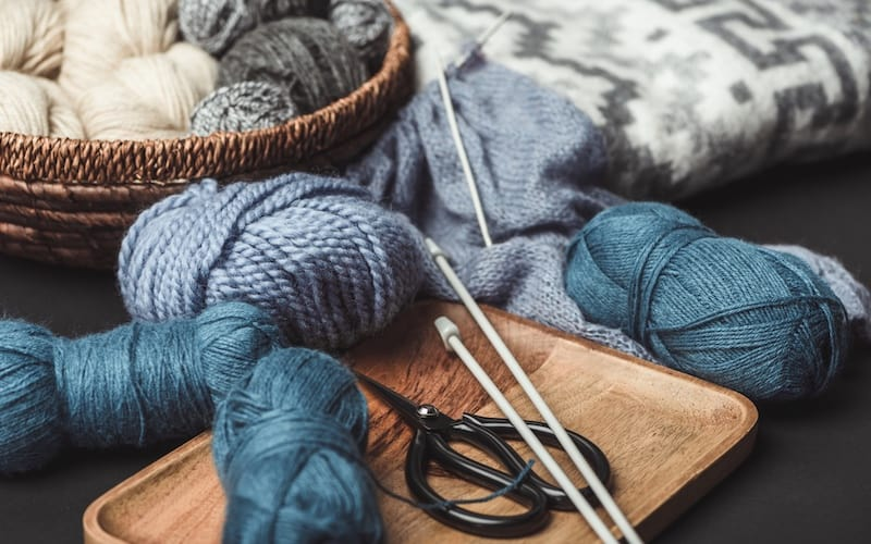 yarn and knitting supplies on a table