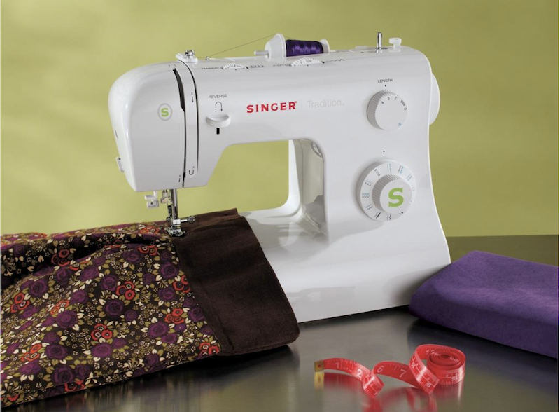 Singer 2277 sewing machine on a tabe