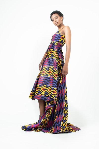 woman wearing a colorful asymmetrical dress