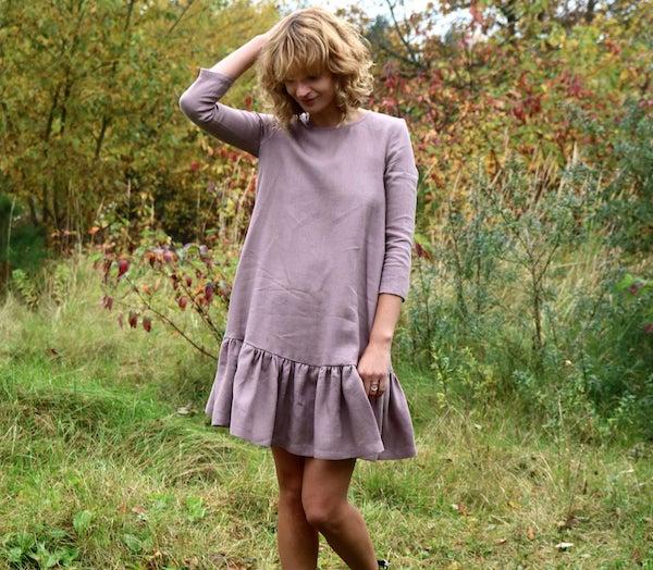 woman wearing a pink drop waist dress