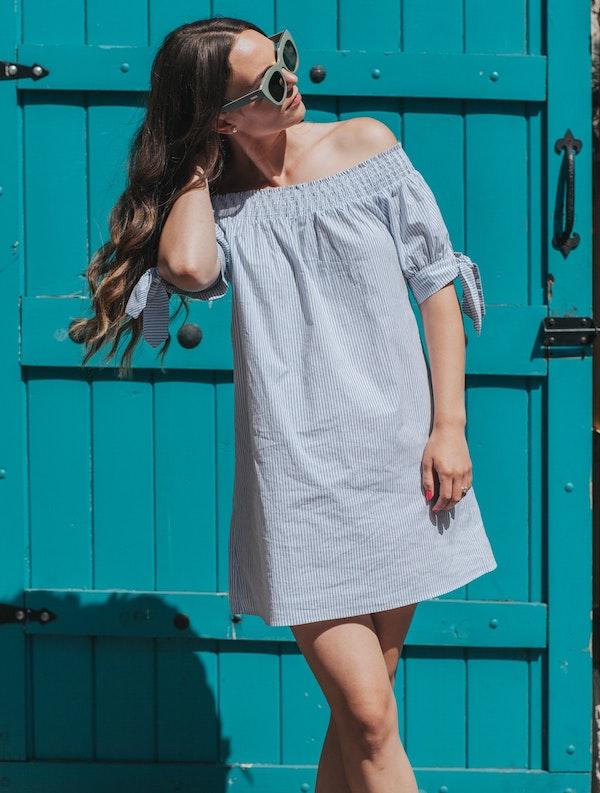 woman wearing an off the shoulder dress