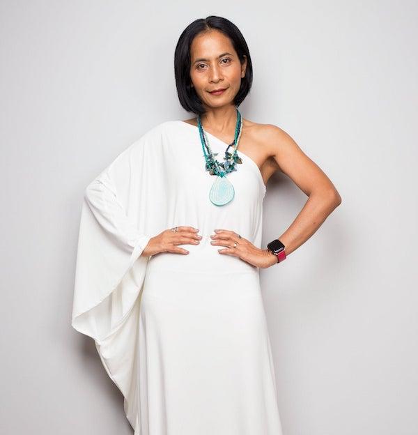 woman wearing a white one-shoulder dress