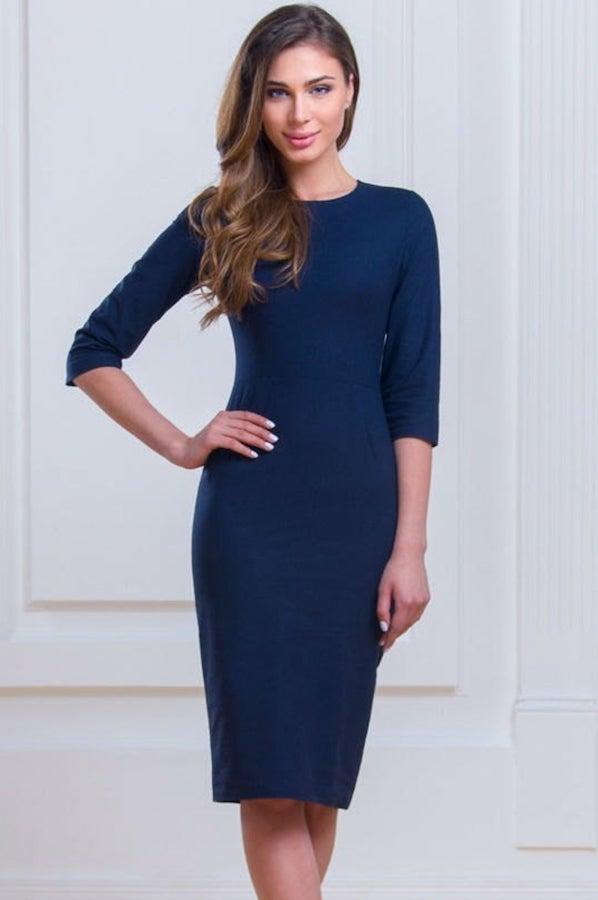 woman wearing a dark blue pencil dress