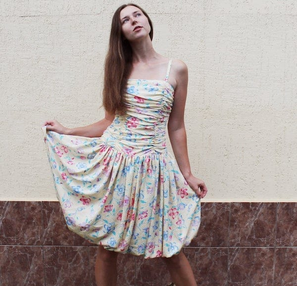 woman wearing a floral printed puffball dress
