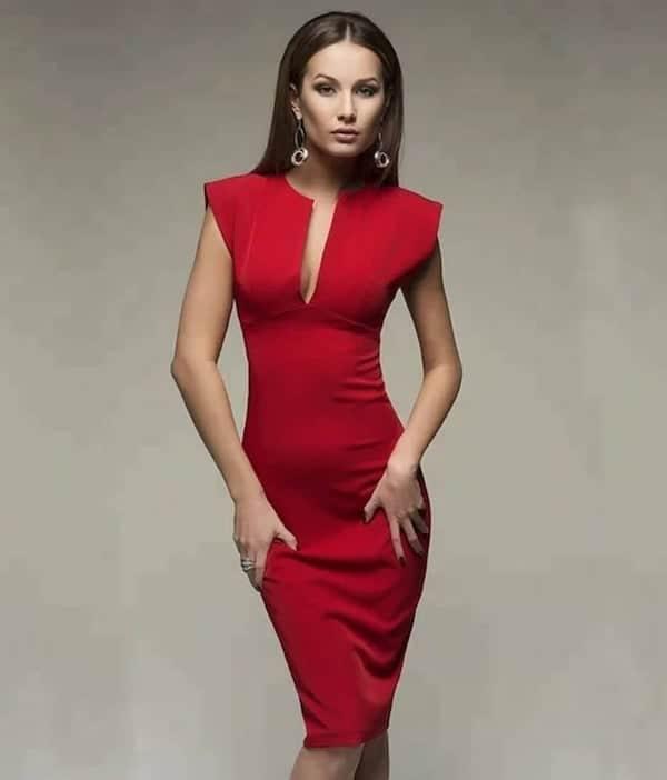 woman wearing a red sheath dress