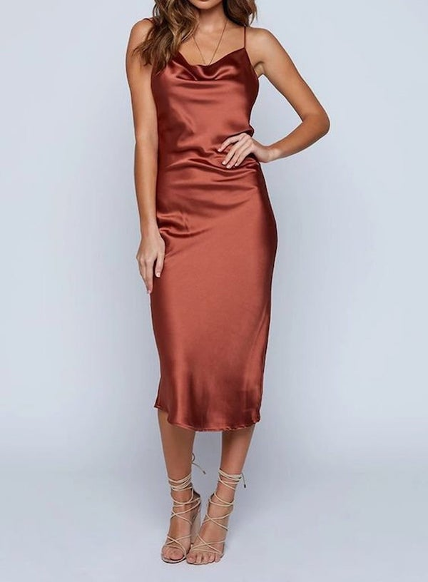 woman wearing a silk slip dress