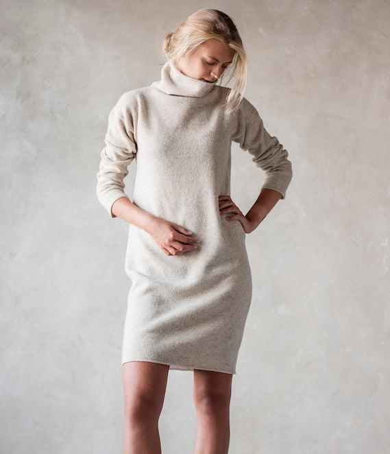 woman wearing a light beige sweater dress