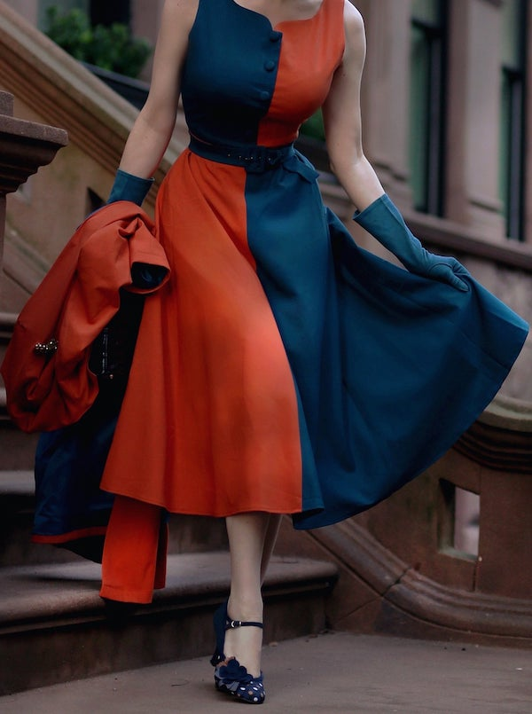 woman wearing a red and blue swing dress