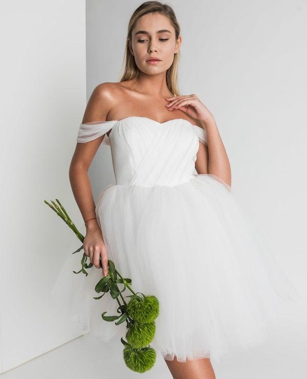 woman wearing a white tutu dress