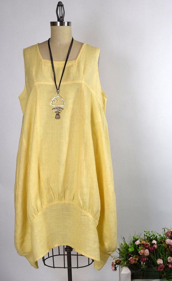 a yellow balloon dress on a dress form