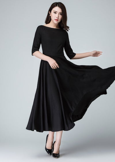woman wearing a black fit and flare dress