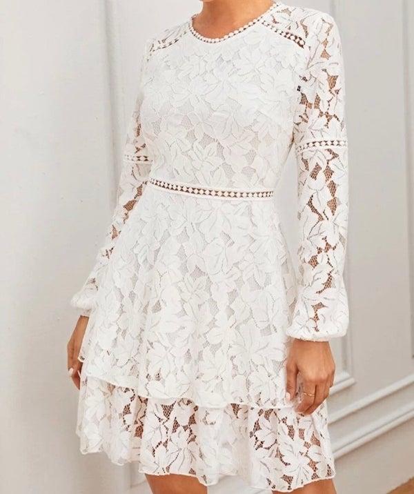 woman wearing a white lace dress