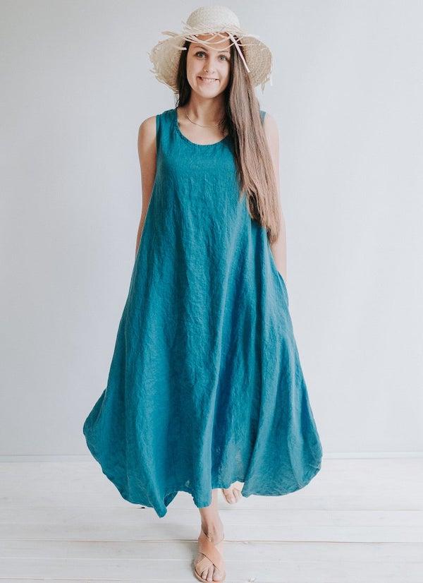 woman wearing a blue tent dress