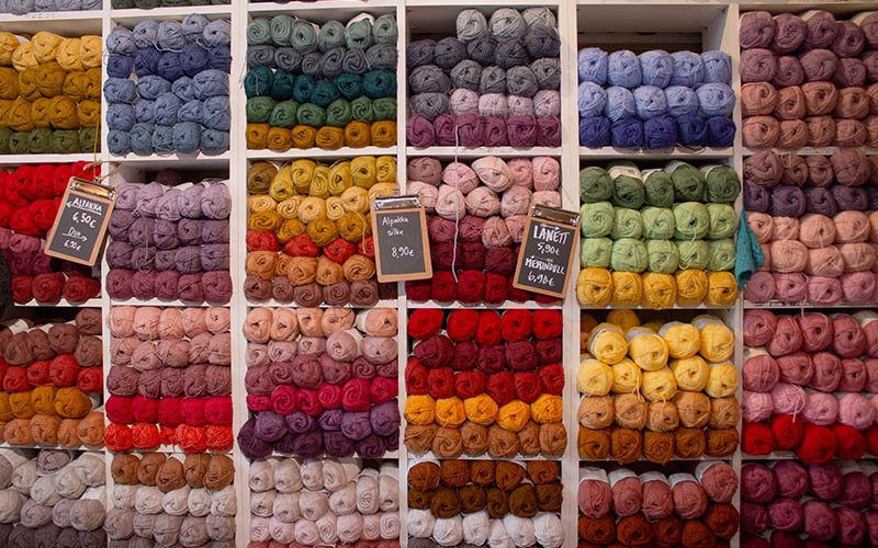 yarn hanks on a shelf in the store